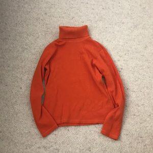 orange sweater, worn twice